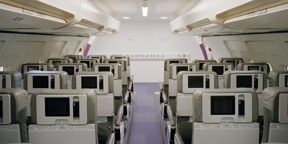 Rows of seats in simulated aircraft cabin
