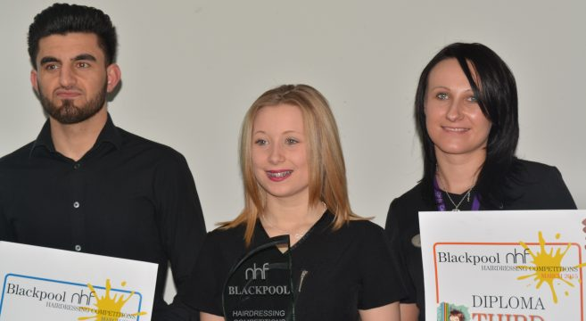 Three hairdressing competition winners holding glass award and second and third place certificates