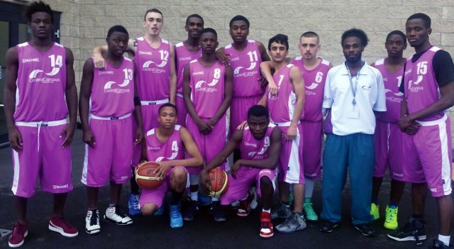 Male basketball team in purple college kit with their coach