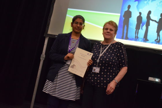 Navreet Kaur receiving an award for Outstanding Achievement