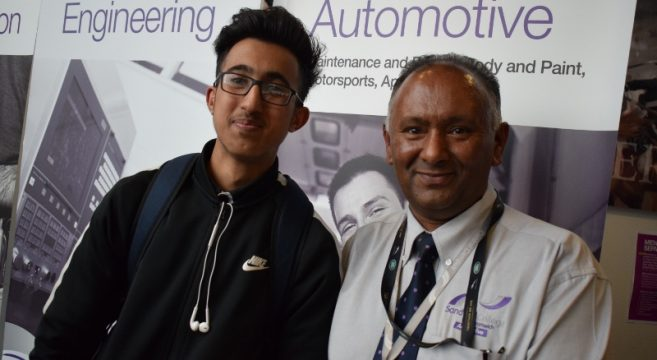 Male automotive student pictured with male automotive teacher