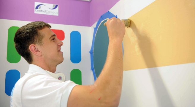 Male student taking part in Dulux painting competition