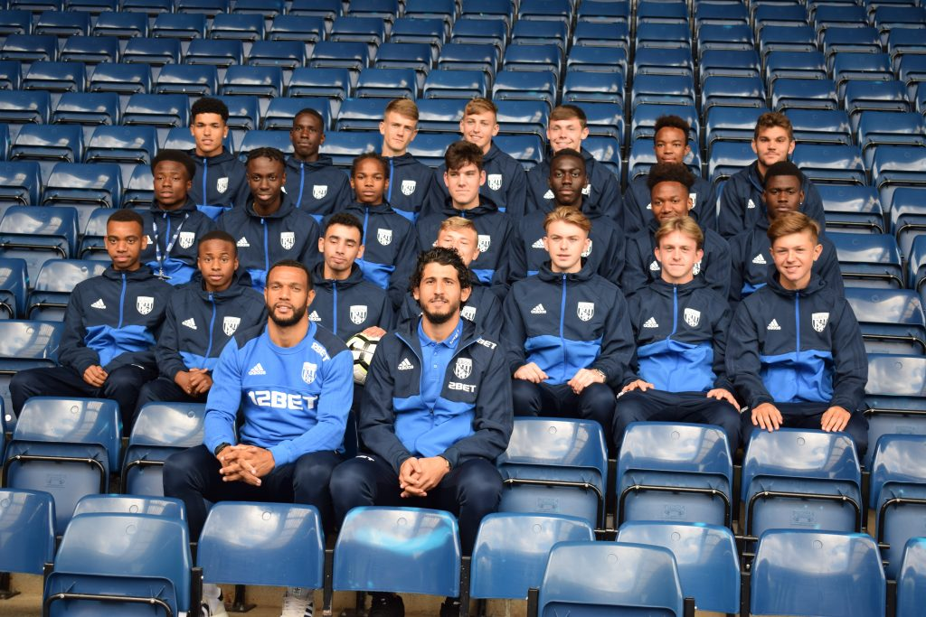 Male sport students sat with Hegazi & Phillips