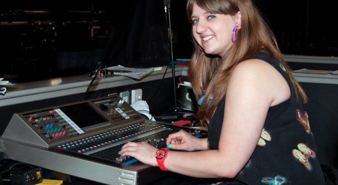 Technical Theatre student operating sound system