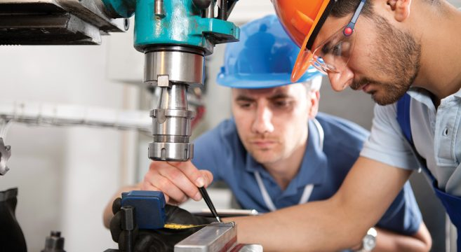 Engineering apprentice being directed by employer
