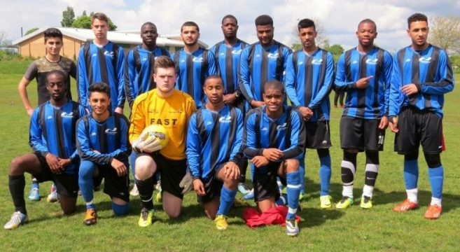 Male student football B team in blue and black striped college kit