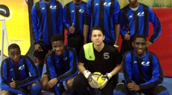 Male futsal team in blue and black striped college kit