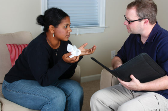 Female patient speaking to counsellor