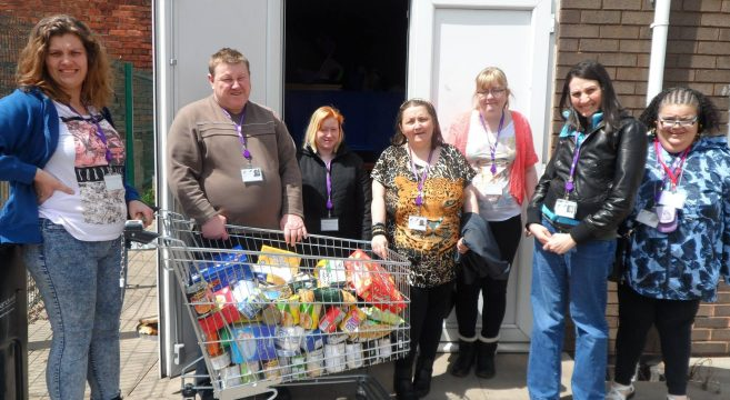 Foundation Learning students with trolley of food outside foodbank