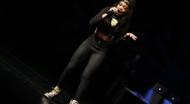 Lady Leshurr rapping on stage