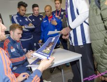 WBA players signing autographs for students