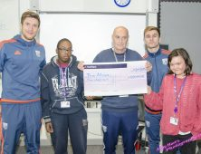 Foundation Learning present cheque to WBA players