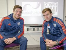 Two WBA players in Albion tracksuits