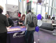 Students talking to lecturers at HE fayre