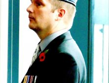 Man in RAF beret wearing medals and poppy