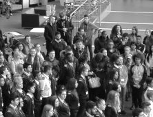 Black and white photo of a crowd of students in atrium