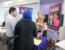 Employer talking to visitors in a careers fayre