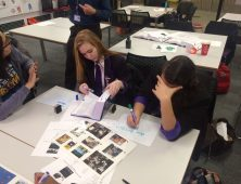 School students working with photos and dictionary
