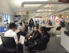 Students on work experience with an employer in a design office