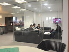 Students sitting in an office with an employer