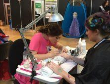 Nail art competitors at table