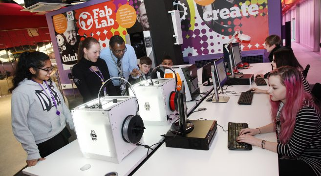 Lecturer teaching students about 3D printers at Fab Lab