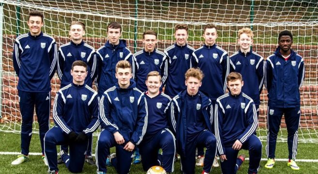 Football team photo in goal mouth
