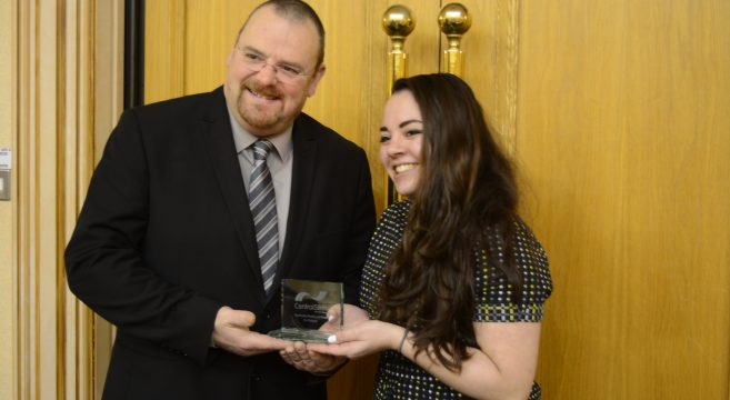 Council leader presenting award to female student