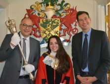 Alice wears the mayoral robes