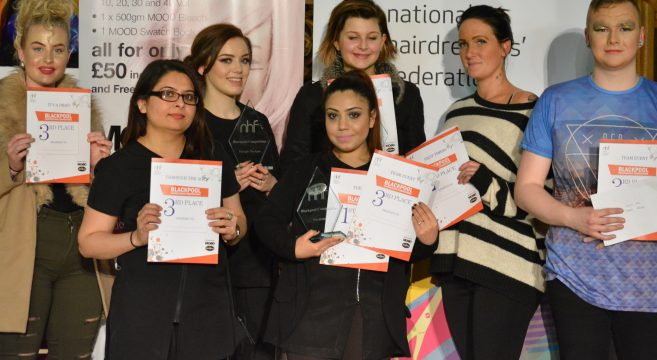 Seven students holding certificates