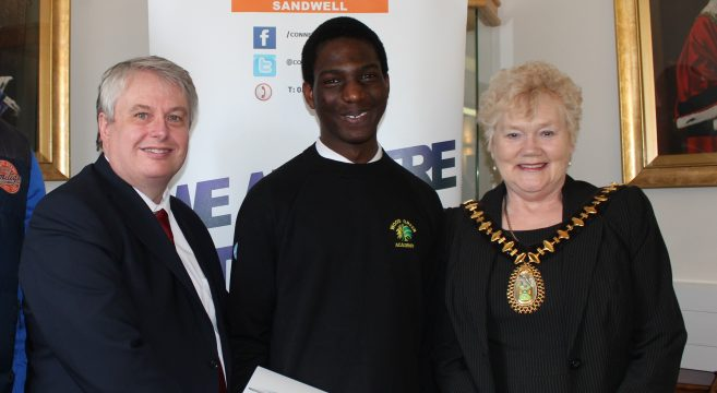 Male school student with Mayor and college principal