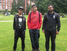 Three male students in Birmingham University grounds