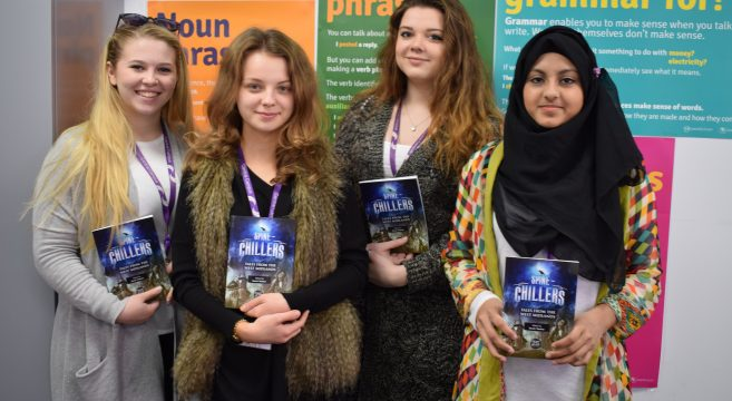 Four female students holding books
