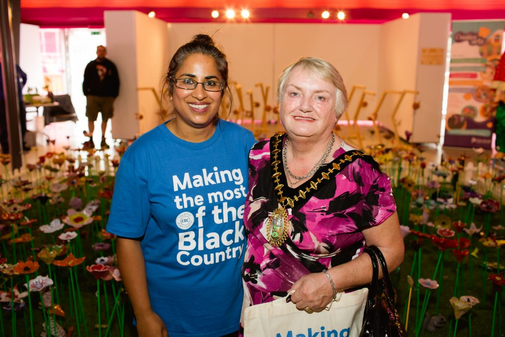 Woman standing with Mayor in front of ceramic garden