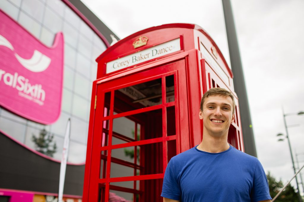 Man in front of red phone box