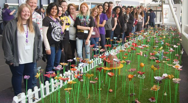 Group of students standing by Ceramic Garden at Central Campus
