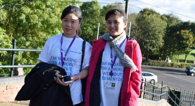Two female students wearing charity t-shirts