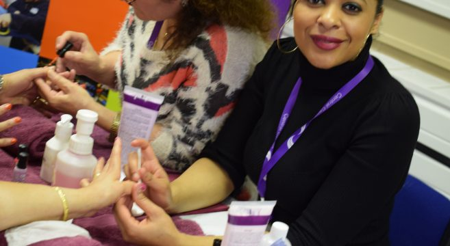 Beauty staff member providing skin care treatment at Jubilee Community Centre