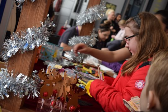 Paper reindeers with red lollipops at a stall at the Sandwell College Christmas Market