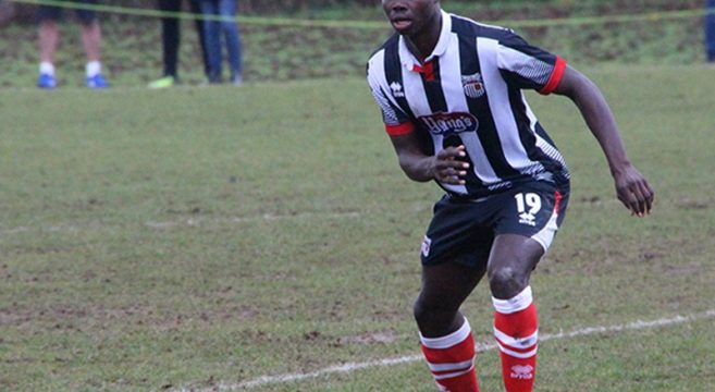 Ahkeem Rose playing for Grimsby Town in a football match