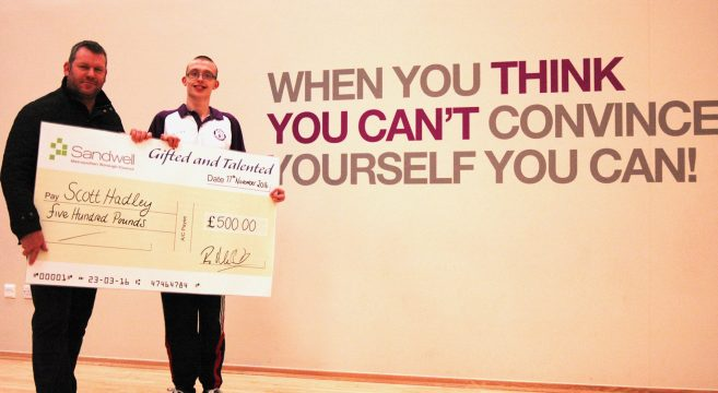 Scott Hadley, paralympian athlete receiving £500 cheque from Sandwell Council