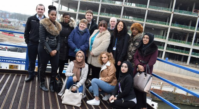 Student on field trip visit pictured with staff