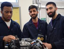 Male Engineering students pictured with engine