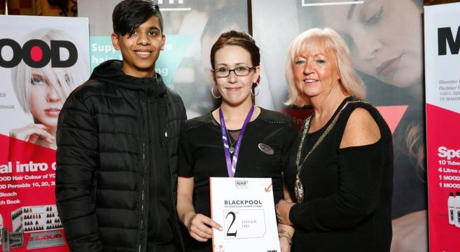 Student receiving hairdressing certificate at the Blackpool Hairdressing Competitions