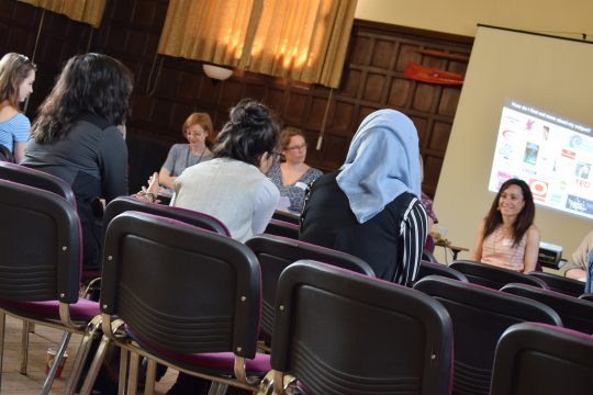 Group of students listening to presentation at Oxford University
