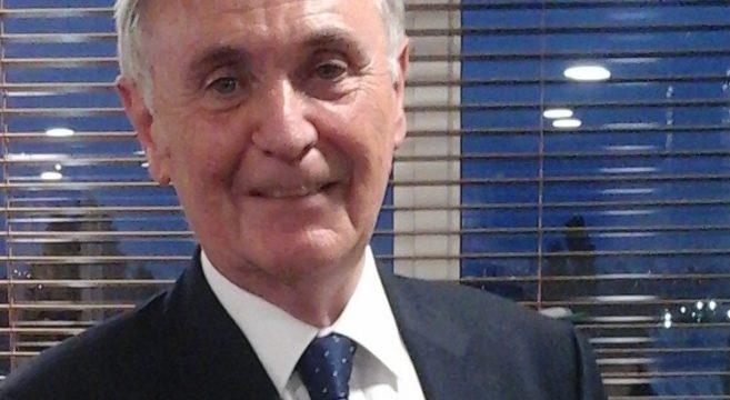 Headshot of John Tew