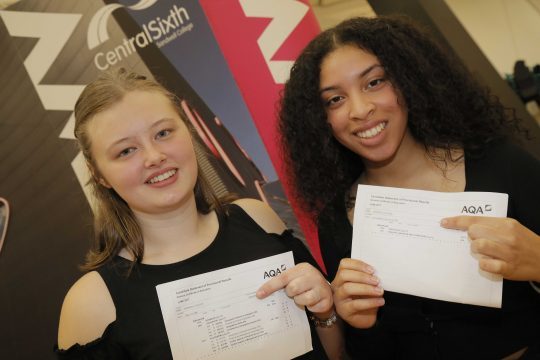 Emily and Alex showing their A Level results
