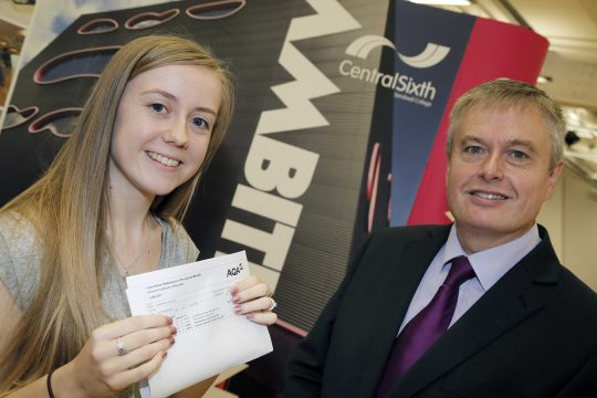 Zoe showing her A Level results pictured with Principal Graham Pennington