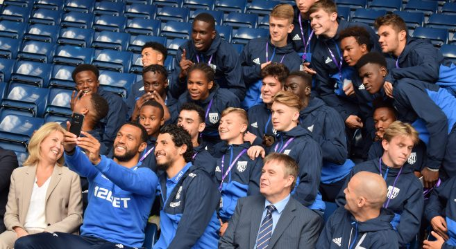 Sports students pictured with West Bromwich Albion players and Sandwell College staff members