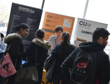 Female students speaking to a representative of Coventry University